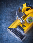 Instruments of measurement and claw hammer — Stock Photo