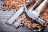 Claw hammer and metal firmer chisels — Stock Photo