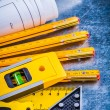 Construction level, blueprints and measurement tools — Stock Photo #77383298
