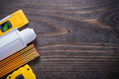 Blueprints, construction level, measuring tape — Stock Photo