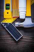 Construction level, ruler, blueprint and hammer — Stock Photo