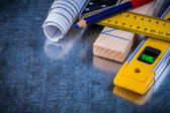 Pencil, blueprints and construction level — Stock Photo