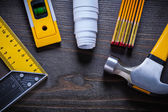 Construction level, blueprint, meter and hammer — Stock Photo