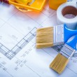 Blueprint with paint roller tray and  brushes — Stock Photo #78564380