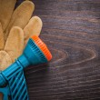 Spray nozzle and leather safety gloves — Stock Photo #78563396