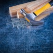 Nails, claw hammer and wooden bricks — Stock Photo #78563664