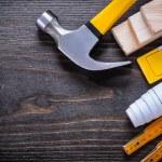 Construction level, hammer, meter and bricks — Stock Photo #78565346