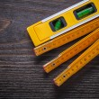 Construction level with wooden meter — Stockfoto #78565824