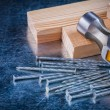 Nails, claw hammer and wooden studs — Stock Photo #78566044