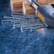 Metal nails with claw hammer — Stock Photo #78566196
