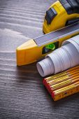 Tape-measure, blueprints, construction level and wooden meter — Stock Photo