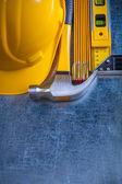 Hammer, wooden meter, construction level — Stock Photo