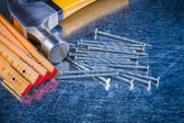Meter, stainless nails and claw hammer — Stock Photo