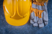 Helmet and safety working gloves — Stock Photo