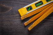 Construction level with wooden meter — Stock Photo