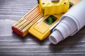 Tape-measure, blueprints and construction level — Stock Photo