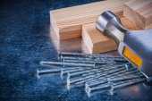 Nails, claw hammer and wooden studs — Stock Photo