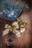 Christmas bows and baubles, fir-tree — Stock Photo