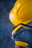 Protective ear muffs and hard hat — Stock Photo