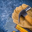 Working gloves, nails and claw hammer — Stock Photo #80369048