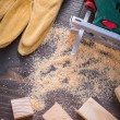 Electric jigsaw sawdust, working gloves — Stock Photo #80367398