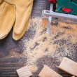 Electric jigsaw sawdust, working gloves — Stock Photo #80367400