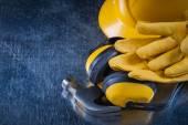 Building helmet, earmuffs, gloves and hammer — Stock Photo