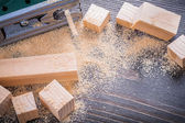 Electric jigsaw sawdust and wooden planks — Stock Photo