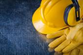 Hard hat, ear muffs and gloves — Stock Photo