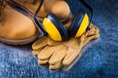Safety boots, gloves and ear muffs — Stock Photo