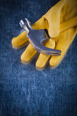 Safety glove with claw hammer — Stock Photo