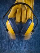 Headphones and leather safety gloves — Stock Photo