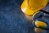 Noise reduction earmuffs and building helmet — Stock Photo