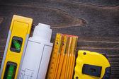 Blueprints, construction level, tape-line — Stock Photo