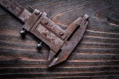 Rusted antique measuring slide caliper — Stock Photo