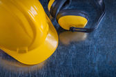Safety ear muffs and work helmet — Stock Photo