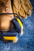 Working boots, protective gloves and headphones — Stock Photo