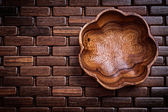 Flowershaped bowl on wooden place mat — Stock Photo