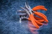 Insulated electric gripping tongs nippers — Stock Photo