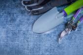 Metal trowel secateurs protective glove — Stock Photo