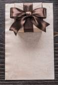 Gift container with bow and paper — Stock Photo