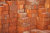 Pile of red bricks prepared for building — Stock Photo
