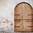 Wooden door in an old style. Courtyard of old castle — Stock Photo #53068419