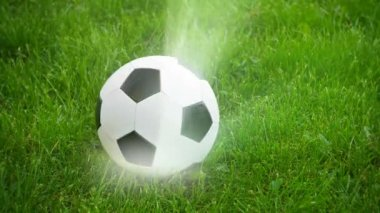 Video 1080p - Soccer ball spinning on the field with rays of light — Stock Video