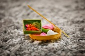 Offerings to gods in Bali with flowers, rice and aroma stick — Stock Photo