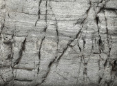 Surface of natural stone with large cracks — Stock Photo