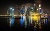 Brilliantly Lit Singapore Skyline from the Harbor at Night — Stock Photo