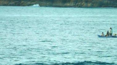 Local fishermen checking nets near the shore of the sea in a small boat — 图库视频影像