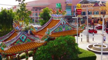 PATONG. PHUKET. THAILAND - CIRCA NOV 2014: View of Jungceylon Shopping Mall over the top of Buddhist shrines and a fountain in Patong. Phuket. Thailand — Stock Video