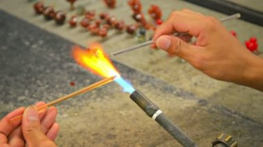 Local Artist Forming Glass Sculptures over a Blowtorch — Stock Video